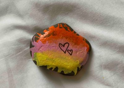 Painted pebble with hearts